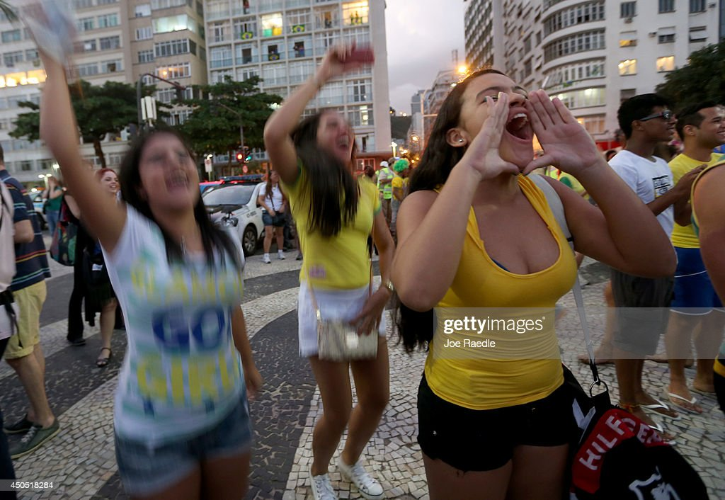 Fans cheer a Brazilian goal as they watch the game on large-screen television sets at the FIFA fan fest on Copacabana beach on June 12, 2014 in Rio de Janeiro, Brazil. Brazil defeated Croatia 3-1 in the first match of 2014 FIFA World Cup today.