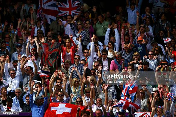 Fans cheer ad Andy Murray of Great Britain plays Roger Federer of Switzerland during the Men's Singles Tennis Gold Medal Match on Day 9 of the London...