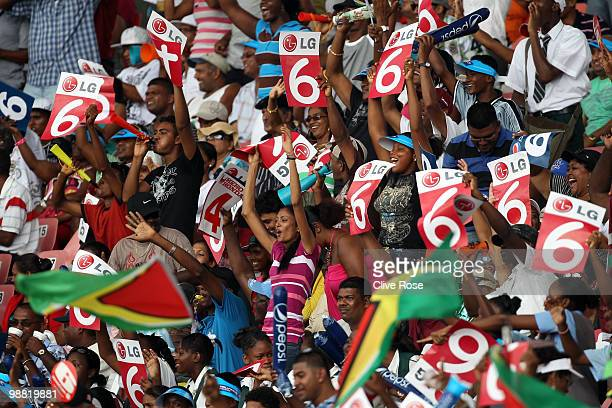 Fans cheer after a six is hit during the ICC T20 World Cup Group D match between West Indies and England at the Guyana National Stadium Cricket...