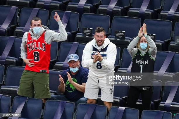 Fans cheer after D'Angelo Russell of the Minnesota Timberwolves made a three-point shot in the fourth quarter against the Chicago Bulls at Target...