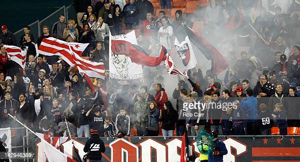 Fans cheer after DC United scored a goal against FC Dallas at RFK Stadium on March 30 2012 in Washington DC