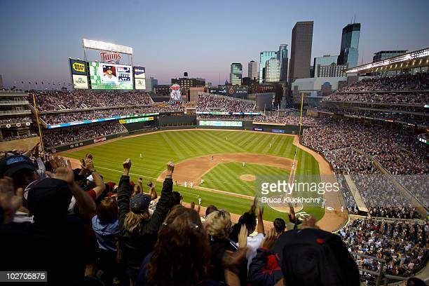 Fans cheer after Denard Span of the Minnesota Twins hits a three run triple against the Detroit Tigers on June 29 2010 at Target Field in Minneapolis...