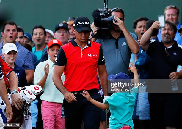 Fans cheer after Jason Day of Australia hit his second shot on the 17th hole during the second round of the 2016 PGA Championship at Baltusrol Golf...