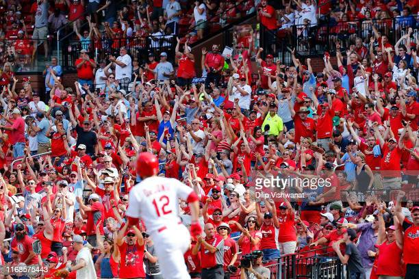Fans cheer after Paul DeJong of the St. Louis Cardinals hit a two-run home run against the Milwaukee Brewers in the seventh inning at Busch Stadium...