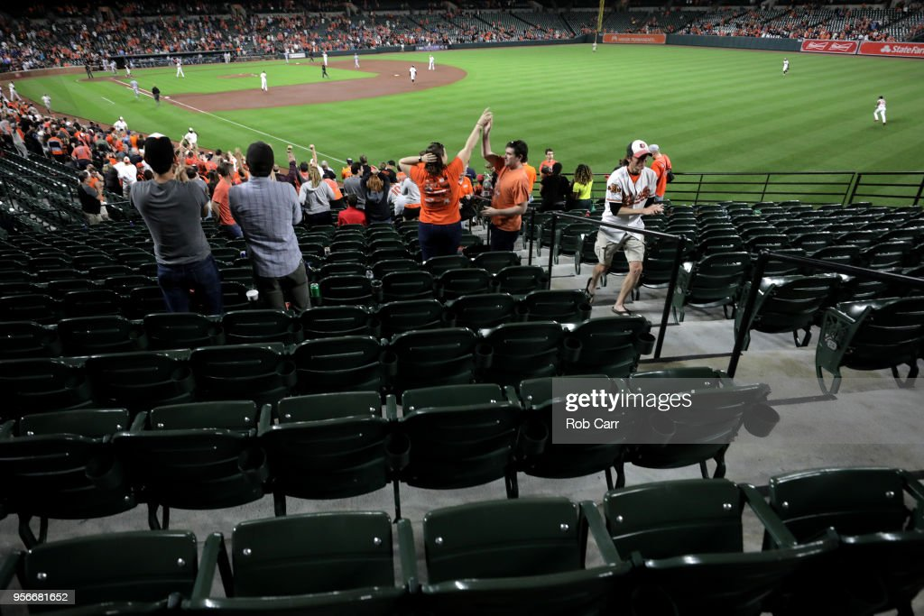 Fans cheer after the Baltimore Orioles defeated the Kansas City Royals 5-3 at Oriole Park at Camden Yards on May 9, 2018 in Baltimore, Maryland.