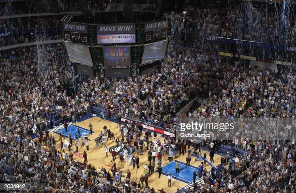 Fans cheer after the Dallas Mavericks defeat the Sacramento Kings in Game seven of the Western Conference Semifinals during the 2003 NBA Playoffs at...
