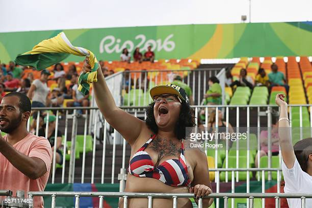 Fans cheer ahead of the Brazil v Colombia contest during the Women's Placing 9-12 rugby on Day 2 of the Rio 2016 Olympic Games at Deodoro Stadium on...