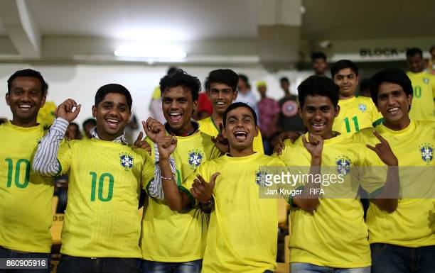 Fans cheer ahead of the FIFA U17 World Cup India 2017 group C match between Niger and Brazil at Pandit Jawaharlal Nehru Stadium on October 13 2017 in...