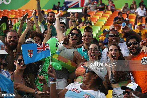 Fans cheer ahead of the second session of Rugby Sevens competition on Day 2 of the Rio 2016 Olympic Games at Deodoro Stadium on August 7, 2016 in Rio...