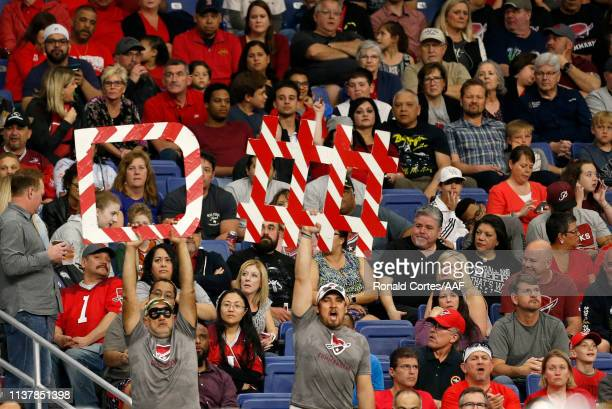 Fans cheer and hold a defense sign during the second quarter of the Alliance of American Football game between the Salt Lake Stallions and the San...