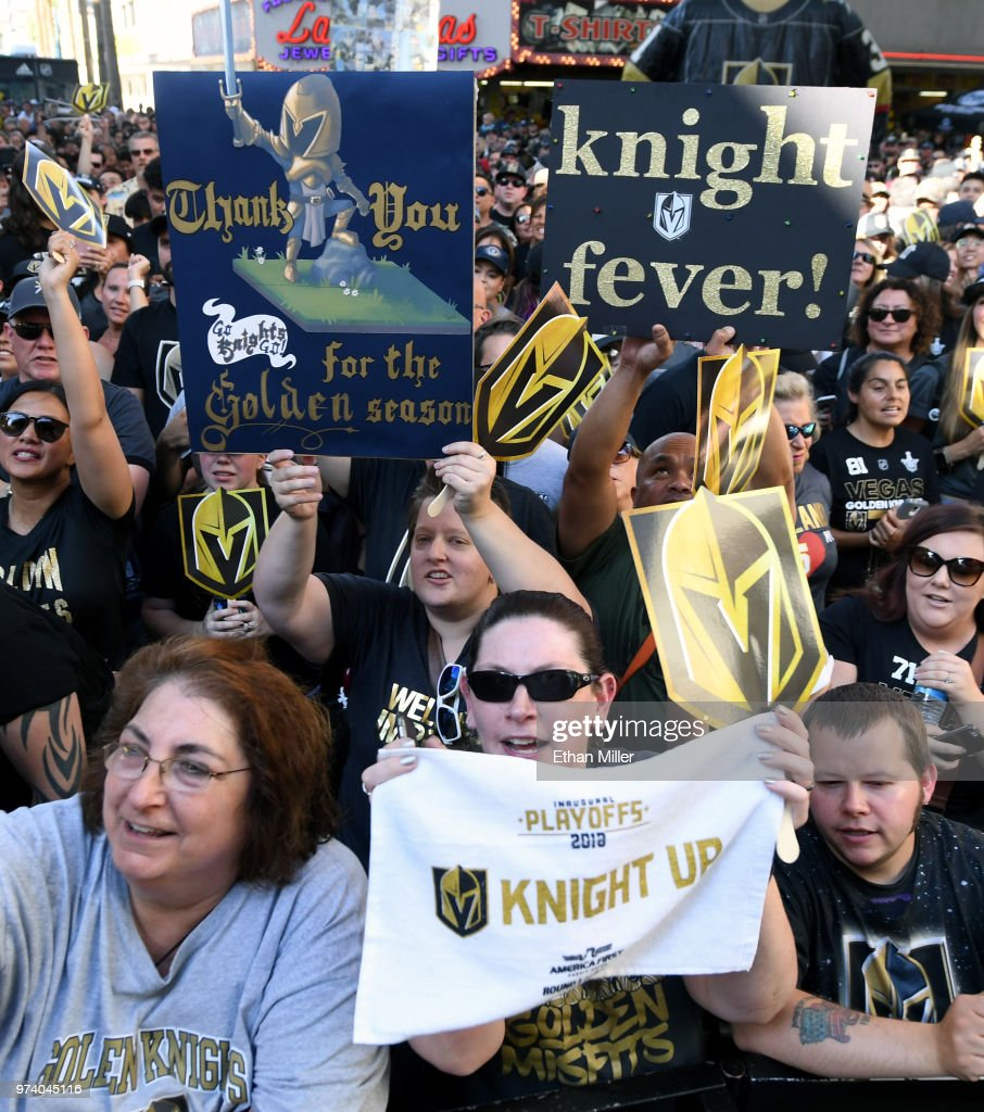 Fans cheer and hold up signs during the Vegas Golden Knights' 'Stick Salute to Vegas and Our Fans' event at the Fremont Street Experience on June 13, 2018 in Las Vegas. Nevada. The Golden Knights made it to the Stanley Cup Final in the team's inaugural season, losing to the Washington Capitals four games to one in the series.