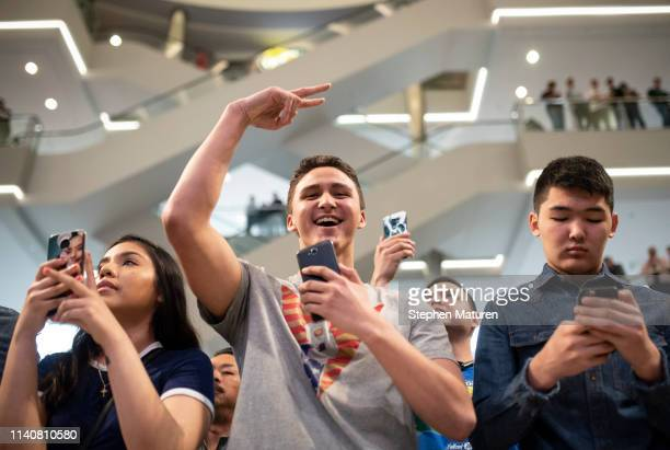 Fans cheer and take photos as Robbie Lawler performs during the UFC Fight Night Open Workouts event at the Mall of America on May 2 2019 in...