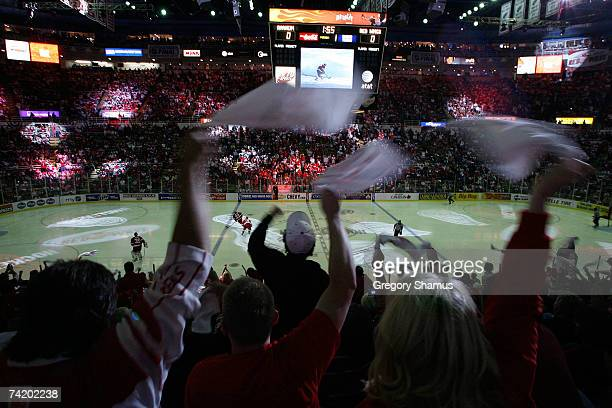 Fans cheer and wave towels as players take the ice for game five of the 2007 Western Conference finals between the Anaheim Ducks and the Detroit Red...