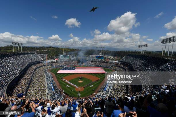 Fans cheer as a Boeing C-17 Globemaster III military transport aircraft conducts a flyover from the 452nd Air Mobility Wing from March Air Reserve...