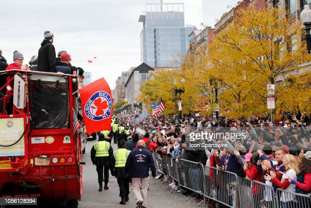 Fans cheer as a duck boat passes during the Boston Red Sox World Series Victory Parade on October 31, 2018 through the streets of Boston,...