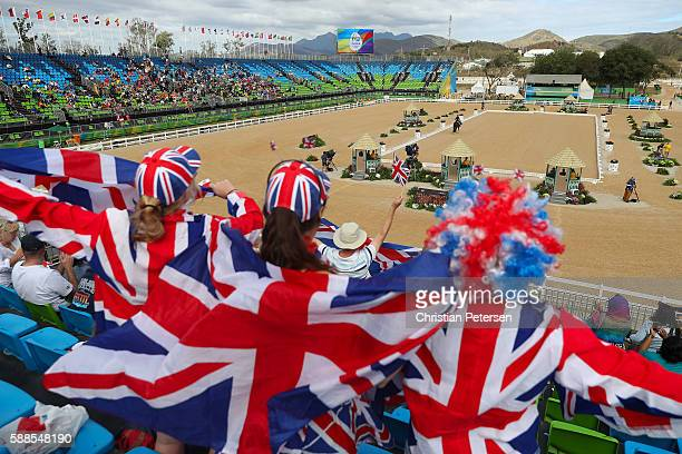 Fans cheer as Charlotte Dujardin of Great Britain riding Valegro competes in the Mens/Womens Team Dressage Grand Prix event on Day 6 of the Rio 2016...