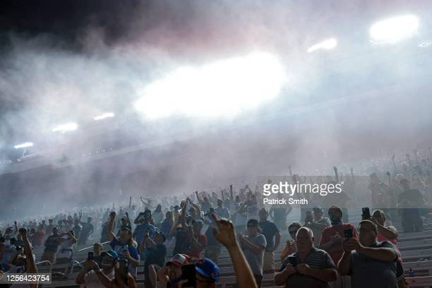 Fans cheer as Chase Elliott, driver of the UniFirst Chevrolet, celebrates after winning the NASCAR Cup Series All-Star Race at Bristol Motor Speedway...