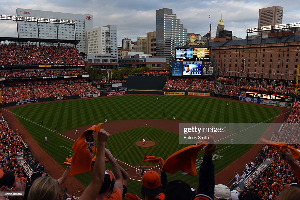 Fans cheer as Chris Tillman #30 of the Baltimore Orioles throws a pitch in the first inning against the Detroit Tigers during Game One of the American League Division Series at Oriole Park at Camden Yards on October 2, 2014 in Baltimore, Maryland.