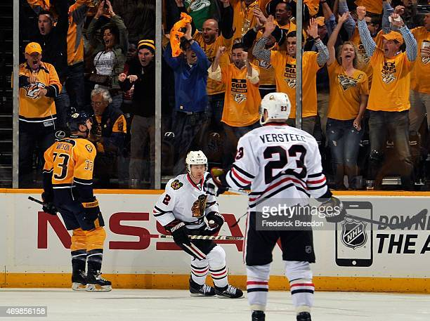 Fans cheer as Colin Wilson of the Nashville Predators celebrates scoring his second goal against the Chicago Blackhawks in the first period of Game...
