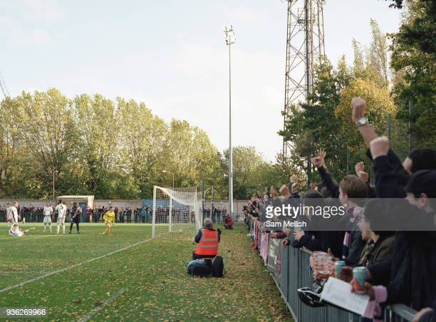 Fans cheer as DHFC score a goal during Dulwich Hamlet FC vs Burgess Hill Town FC at Champion Hill on 21st October 2017 in South London in the United...