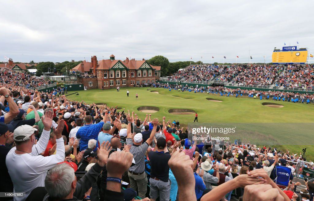 Fans cheer as Ernie Els of South Africa reacts to a birdie putt on the 18th green during the final round of the 141st Open Championship at Royal Lytham & St. Annes Golf Club on July 22, 2012 in Lytham St Annes, England.