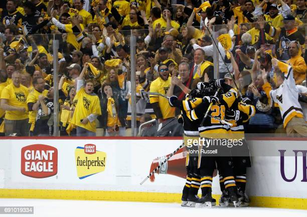 Fans cheer as Evgeni Malkin of the Pittsburgh Penguins celebrates his goal with teammates during the third period of Game Two of the 2017 NHL Stanley...