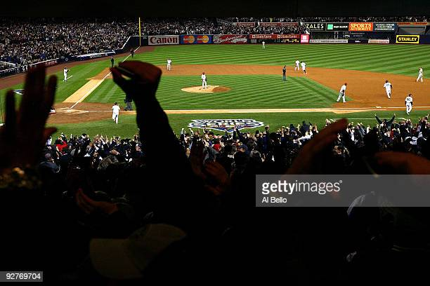 Fans cheer as Hideki Matsui of the New York Yankees runs the bases on his 2-run home run in the bottom of the second inning against the Philadelphia...
