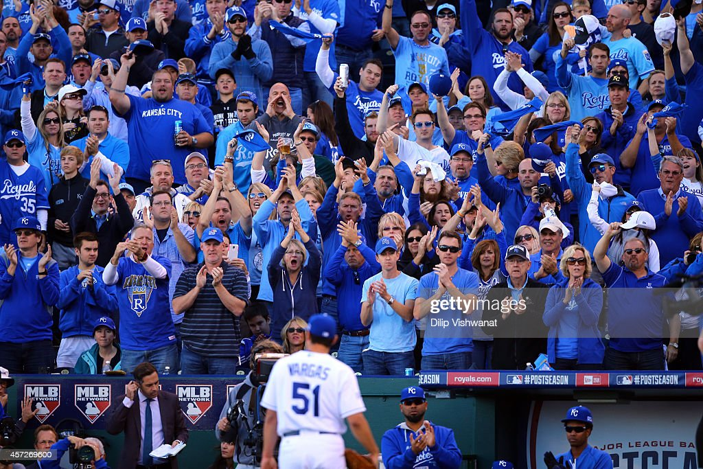 Fans cheer as Jason Vargas #51 of the Kansas City Royals walks back to the dugout after being relieved in the sixth inning against the Baltimore Orioles during Game Four of the American League Championship Series at Kauffman Stadium on October 15, 2014 in Kansas City, Missouri.