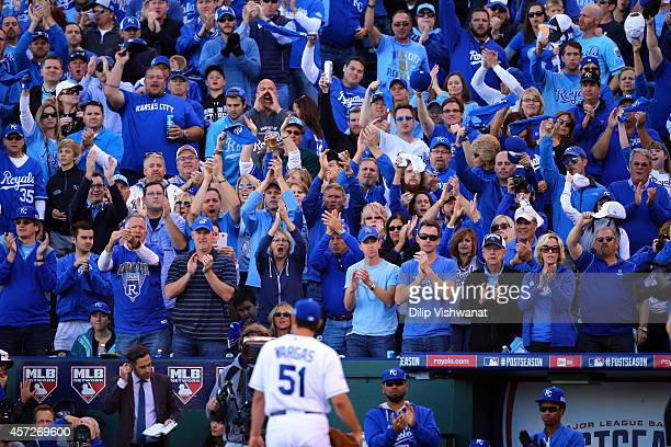 Fans cheer as Jason Vargas of the Kansas City Royals walks back to the dugout after being relieved in the sixth inning against the Baltimore Orioles...