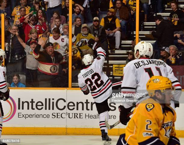 Fans cheer as Jordin Tootoo of the Chicago Blackhawks celebrates after scoring a goal against his former team the Nashville Predators during the...