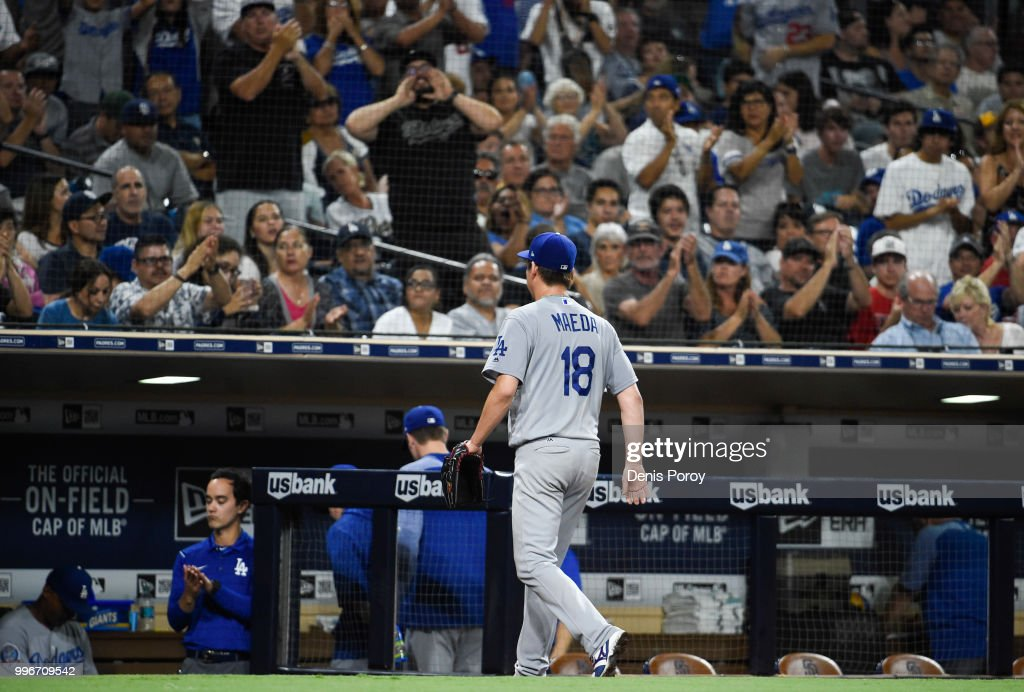 Fans cheer as Kenta Maeda #18 of the Los Angeles Dodgers leaves the game in the sixth inning of a baseball game against the San Diego Padres at PETCO Park on July 11, 2018 in San Diego, California.