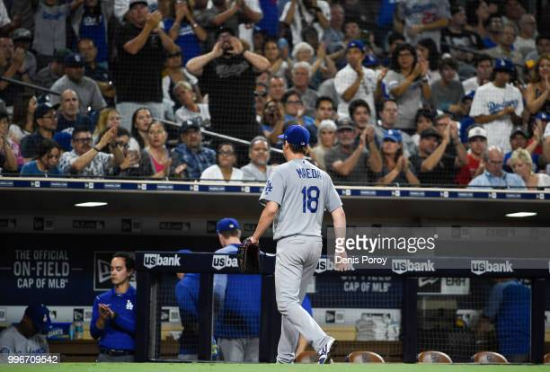 Fans cheer as Kenta Maeda of the Los Angeles Dodgers leaves the game in the sixth inning of a baseball game against the San Diego Padres at PETCO...