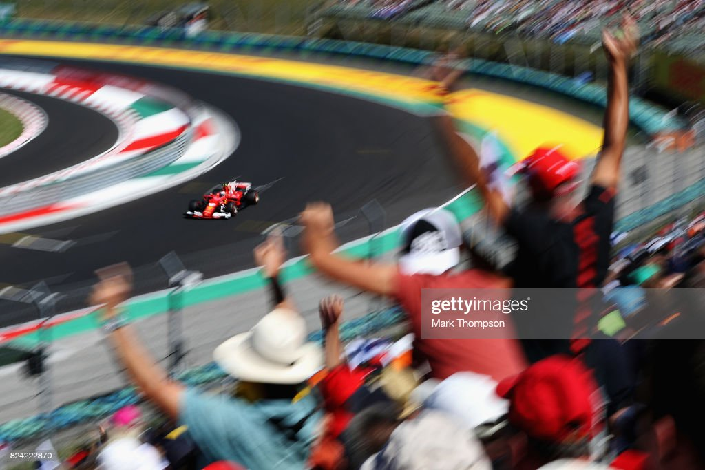 Fans cheer as Kimi Raikkonen of Finland driving the (7) Scuderia Ferrari SF70H rounds the last corner during qualifying for the Formula One Grand Prix of Hungary at Hungaroring on July 29, 2017 in Budapest, Hungary.