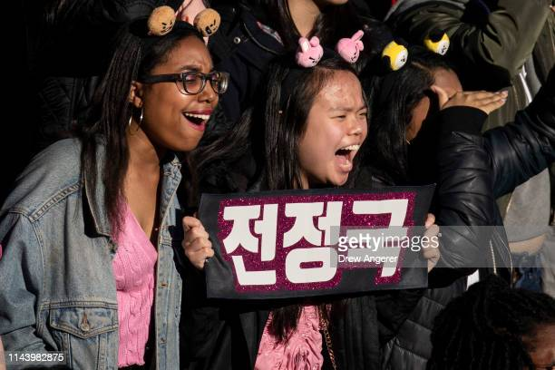 Fans cheer as K-Pop group BTS performs in Central Park, May 15, 2019 in New York City. Fans waited in line for days to see the group perform as part...