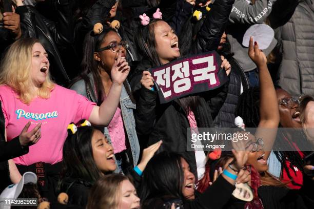 Fans cheer as KPop group BTS performs in Central Park May 15 2019 in New York City Fans waited in line for days to see the group perform as part of...