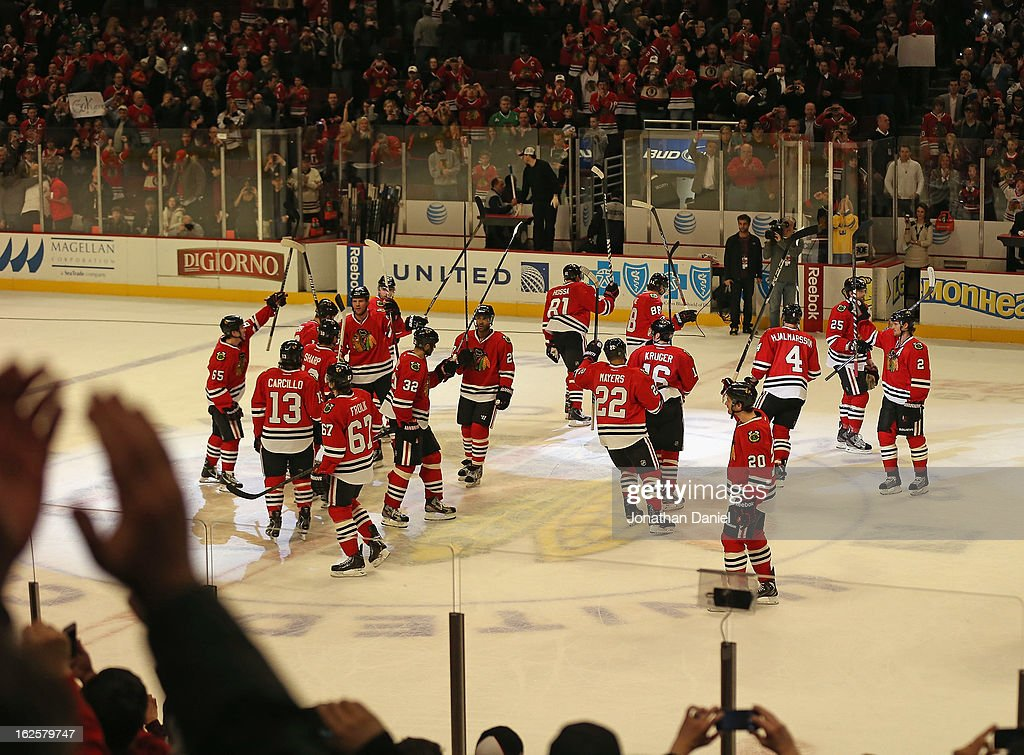 Fans cheer as members of the Chicago Blackhawks salute the crowd after a win over the Columbus Blue Jackets at the United Center on February 24, 2013 in Chicago, Illinois. The Blackhawks defeated the Blue Jackets 1-0.