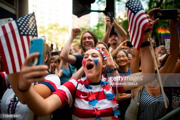 TOPSHOT Fans cheer as members of the World Cupwinning US women's soccer team take part in a ticker tape parade for the women's World Cup champions on...