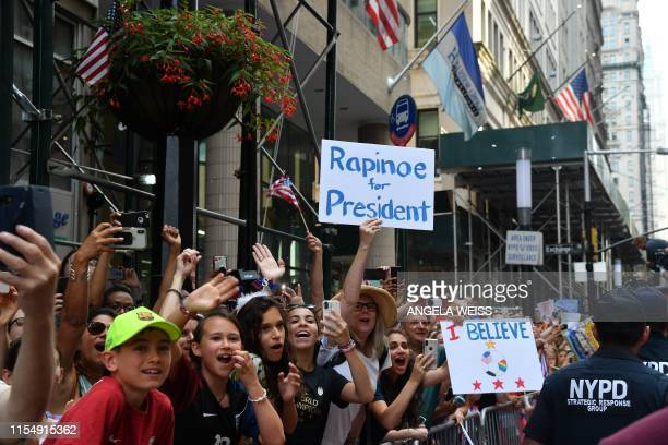Fans cheer as members of the World Cupwinning US women's team take part in a ticker tape parade for the women's World Cup champions on July 10 2019...