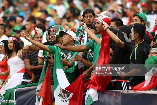 Fans cheer as Mexico plays Jamaica in the CONCACAF Gold Cup Final at Lincoln Financial Field on July 26 2015 in Philadelphia Pennsylvania Mexico won...