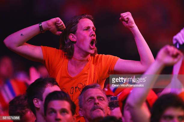 Fans cheer as Michael van Gerwen of the Netherlands plays a shot in his match against Phil 'The Power' Taylor of England during the Darts Betway...