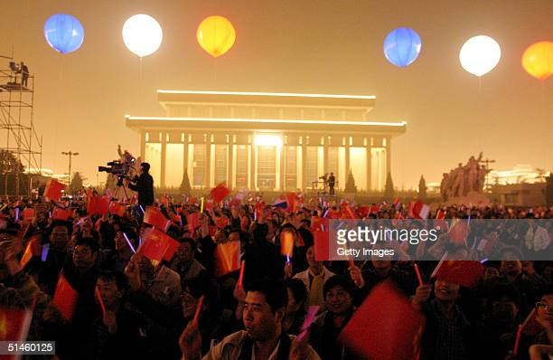 Fans cheer as music and light artist Jean Michel Jarre performs during his concert in Tiananmen Square for the official launch of the Year of France...