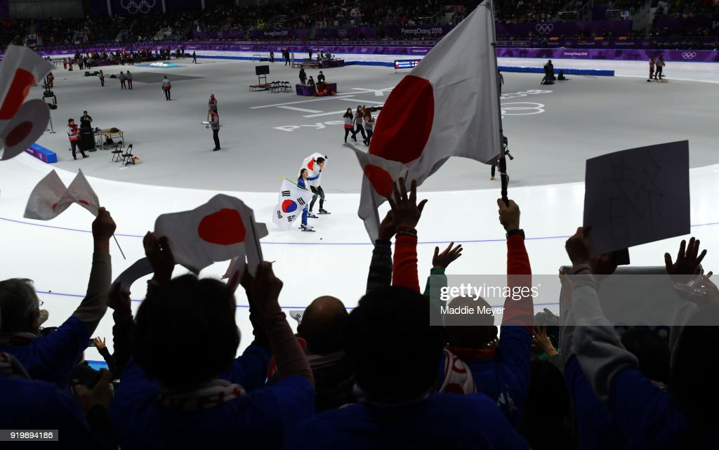 Fans cheer as Nao Kodaira of Japan and Sang-Hwa Lee of Korea celebrate after winning the gold and silver medal, respectively, during the Ladies' 500m Individual Speed Skating Final on day nine of the PyeongChang 2018 Winter Olympic Games at Gangneung Oval on February 18, 2018 in Gangneung, South Korea.
