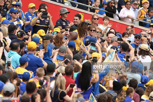 Fans cheer as Nic Naitanui walks out onto the field during a West Coast Eagles AFL training session at Subiaco Oval on September 24 2018 in Perth...