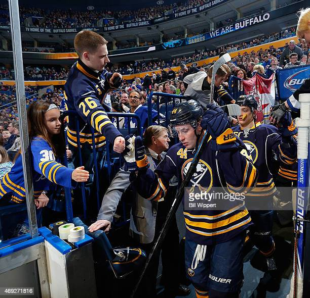 Fans cheer as Nicolas Deslauriers of the Buffalo Sabres heads to the ice for a game against the Toronto Maple Leafs on April 1 2015 at the First...