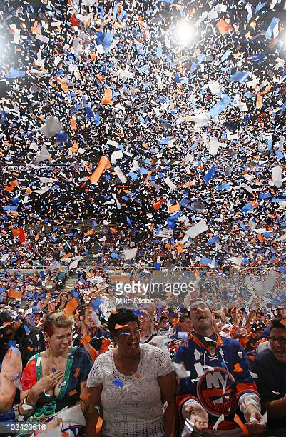 Fans cheer as Nino Niederreiter is drafted fifth overall by the New York Islanders during the Draft Day Party on June 25 2010 at Nassau Coliseum in...