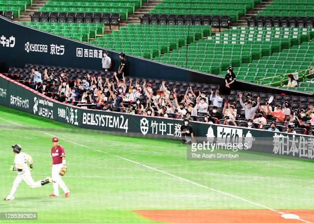 Fans cheer as Nobuhiro Matsuda of the Fukuoka SoftBank Hawks hits a solo homer in the bottom of 2nd inning during the game between Tohoku Rakuten...