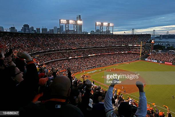 Fans cheer as Pablo Sandoval of the San Francisco Giants rounds the bases after scoring a two run home run to left field against Justin Verlander of...
