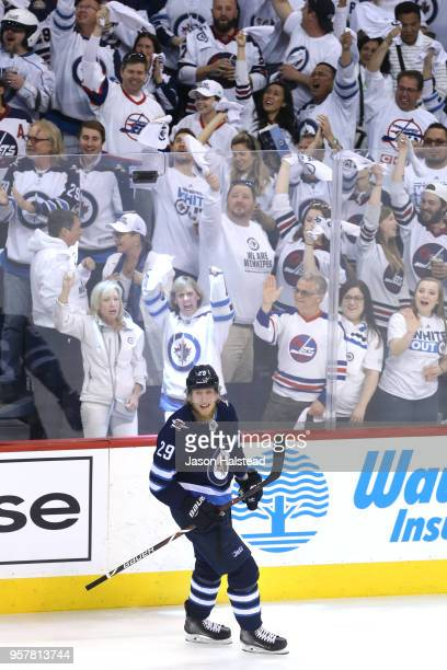 Fans cheer as Patrik Laine of the Winnipeg Jets celebrates his first period goal against the Vegas Golden Knights in Game One of the Western...