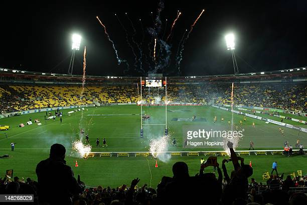 Fans cheer as players run onto the field during the Super Rugby round 18 game between the Hurricanes and the Chiefs at Westpac Stadium on July 13,...