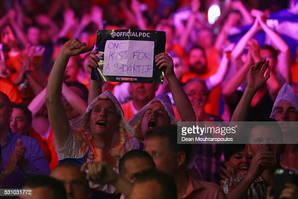 Fans cheer as Robert Thornton of Scotland plays against James Wade of England during the Darts Betway Premier League Night 15 at Rotterdam Ahoy on...